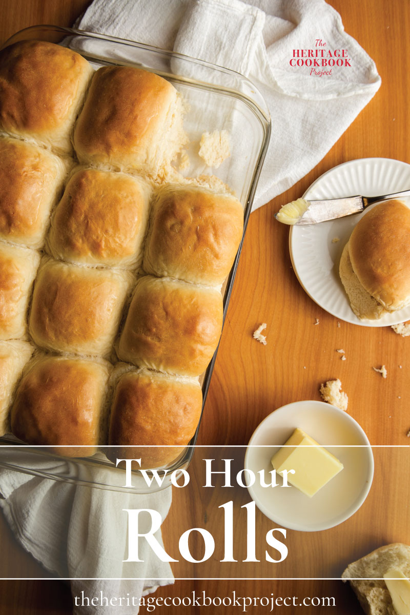 Two Hour Rolls in baking pan with a roll on a plate with butter.