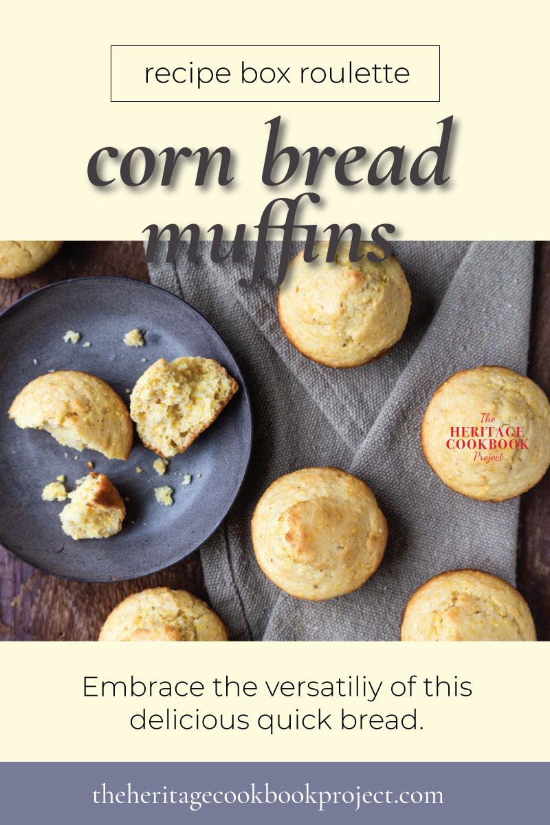 Corn bread muffins on a table top with one broken apart on a plate.