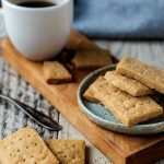 3 ingredient Scotch Shortbread Cookies piles on a plate with coffee and a spoon.
